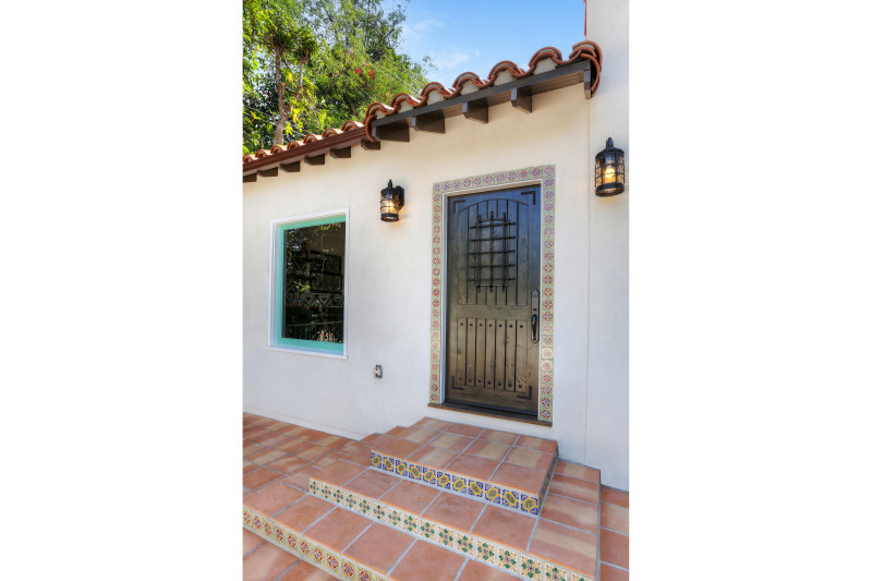 real estate development, spanish revival, los feliz, los angeles, white stucco, teal windows, spanish colonial, hand painted tile