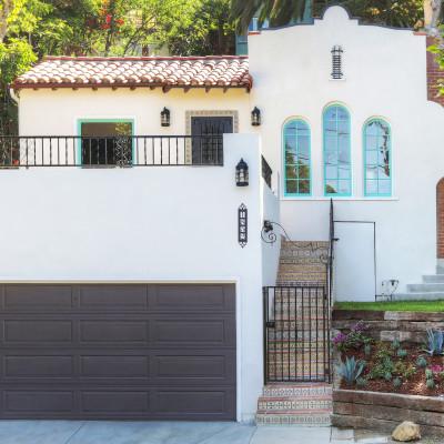 real estate development, spanish revival, los feliz, los angeles, white stucco, teal windows, spanish colonial, hand painted tile